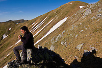 The photographer Bruno D'Amicis looking for bears from high viewpoint. Western Tatras, Slovakia. June 2009. Mission: Ticha