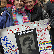 Christina Lawrence and her sister holding up poster sign with photo of their mother &quot;Hear Our Voice&quot;.<br />
