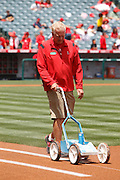 ANAHEIM, CA - MAY 08:  A groundskeeper lines the first base line for the game between the Cleveland Indians and the Los Angeles Angels of Anaheim on Sunday, May 8, 2011 at Angel Stadium in Anaheim, California. The Angels won the game 6-5. (Photo by Paul Spinelli/MLB Photos via Getty Images)