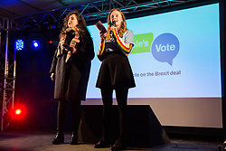 London, UK. 15th January, 2019. Doire Finn and Tara Grace Connolly of Our Future Our Choice address pro-EU activists attending a People's Vote rally in Parliament Square as MPs vote in the House of Commons on Prime Minister Theresa May's proposed final Brexit withdrawal agreement.