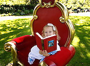 No fee for Repro: 26/07/2012.'Alice' Kayla Cooke aged 5 from Drumcondra, Dublin pictured reading 'Alice in Wonderland? at the announcement that leading Irish authors Cathy Kelly and Ireland's new children's laureate Niamh Sharkey pledged their support for the Eason 'Get Into Reading' campaign which aims to highlight the importance of reading, especially with young children. Eason commissioned research into the nation's reading habits which revealed almost one in five (18%) Irish parents never read to their children. Eason is asking the Irish public to pledge their support at Easons.com/getintoreading. Picture Andres Poveda CPR.