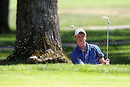 Andy Hansen of Mequon, Wisconsin hits out of a bunker on the 16th hole during the first round of the Greater Cedar Rapids Open held at Hunters Ridge Golf Course in Marion on Friday, July 22, 2011.
