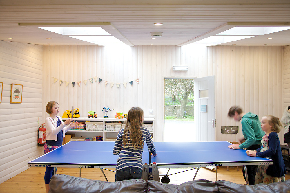 The games room at Pickwell Manor, Georgeham, North Devon, UK. From left to right: Liza Baker (9), Molly Elliott (10), Zac Baker (11), <br /> Milly-grace Elliott (8).<br /> CREDIT: Vanessa Berberian for The Wall Street Journal<br /> HOUSESHARE