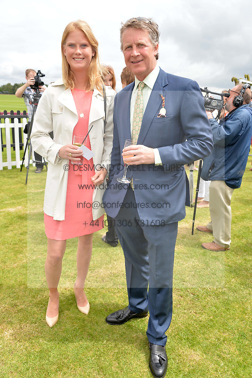 BEN SANGSTER and his daughter ELIZA SANGSTER at the Cartier Queen's Cup Final polo held at Guards Polo Club, Smith's Lawn, Windsor Great Park, Egham, Surrey on 15th June 2014.