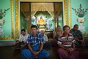 Patients at a mobile clinic at Wannawarthi Monastery in South Dagon township practise five minutes of meditation. At every clinic, the doctors begin the day by leading a group patient activity session to encourage meditation, mindfulness and exercise as elements of a healthy lifestyle.