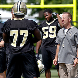 June 5, 2012; Metairie, LA, USA; New Orleans Saints defensive coordinator Steve Spagnuolo with defensive tackle Brodrick Bunkley (77) during a minicamp session at the team's practice facility. Mandatory Credit: Derick E. Hingle-US PRESSWIRE