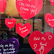 Valentine's Day decorations in window of Cinammon Roller bakery at Pike Place Market, Seattle, Washington