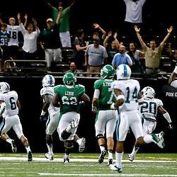 Oct 5, 2013; New Orleans, LA, USA; Tulane Green Wave cornerback Lorenzo Doss (6) returns an interception for a touchdown against the North Texas Mean Green during the second half at Mercedes-Benz Superdome. Tulane defeated North Texas 24-21. Mandatory Credit: Derick E. Hingle-USA TODAY Sports