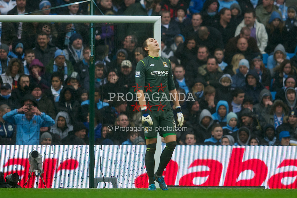 MANCHESTER, ENGLAND - Sunday, January 8, 2012: Manchester City's goalkeeper Costel Pantilimon looks dejected as Manchester United score the second goal against Manchester City during the FA Cup 3rd Round match at the City of Manchester Stadium. (Pic by David Rawcliffe/Propaganda)