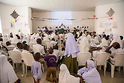 School children taking part in a debate at the VSO ICS Community Action Day CAD held for local members of the community in Y2K Hall Lindi, Lindi region. Tanzania.