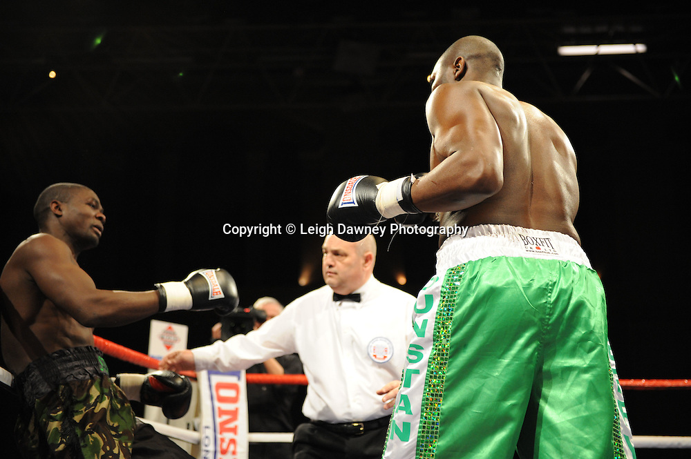 Terry Dunstan (light green shorts) defeats Hastings Rasani on the 9th April 2010 at Alexandra Palace, London. Matchroom Sport. Photo credit: © Leigh Dawney