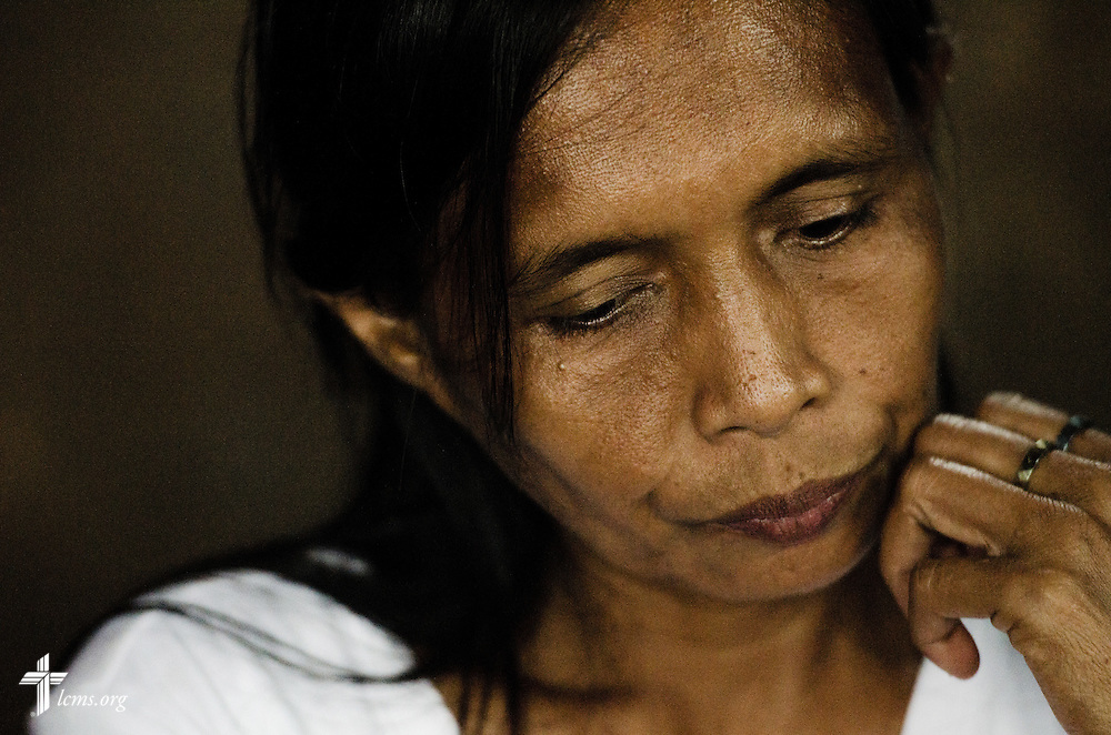 A member of Christ Lutheran Church affected by Typhoon Haiyan pauses during an interview in Tacloban, Leyte Province, Philippines, on Friday, March 14, 2014. LCMS Communications/Erik M. Lunsford