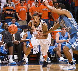 Virginia guard Calvin Baker (4) is guarded by North Carolina guard/forward Danny Green (14).  The the #5 ranked North Carolina Tar Heels defeated the Virginia Cavaliers 83-61 in NCAA Basketball at the John Paul Jones Arena on the Grounds of the University of Virginia in Charlottesville, VA on January 15, 2009.