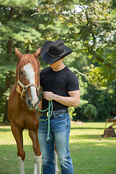 cowboy outdoors with a horse