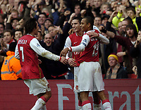 Photo: Olly Greenwood.<br />Arsenal v Tottenham Hotspur. The Barclays Premiership. 02/12/2006. Arsenal's Gilberto celebrates scoring from the penalty spot with Robin Van Persie and Tomas Rosicky