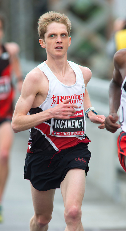 (Ottawa, Canada---24 May 2015) Lucas McAneney (Canada) gives chase across the Alexandra Bridge to finish second Canadian and ninth overall in the marathon during the Tamarack Run Ottawa Race Weekend.
