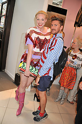 GWENDOLINE CHRISTIE and HENRY HOLLAND at a party to celebrate the launch of Louise Gray's make-up and clothing collections for Topshop held at Topshop Edited, 286 Regent Street, London on 22nd August 2012.