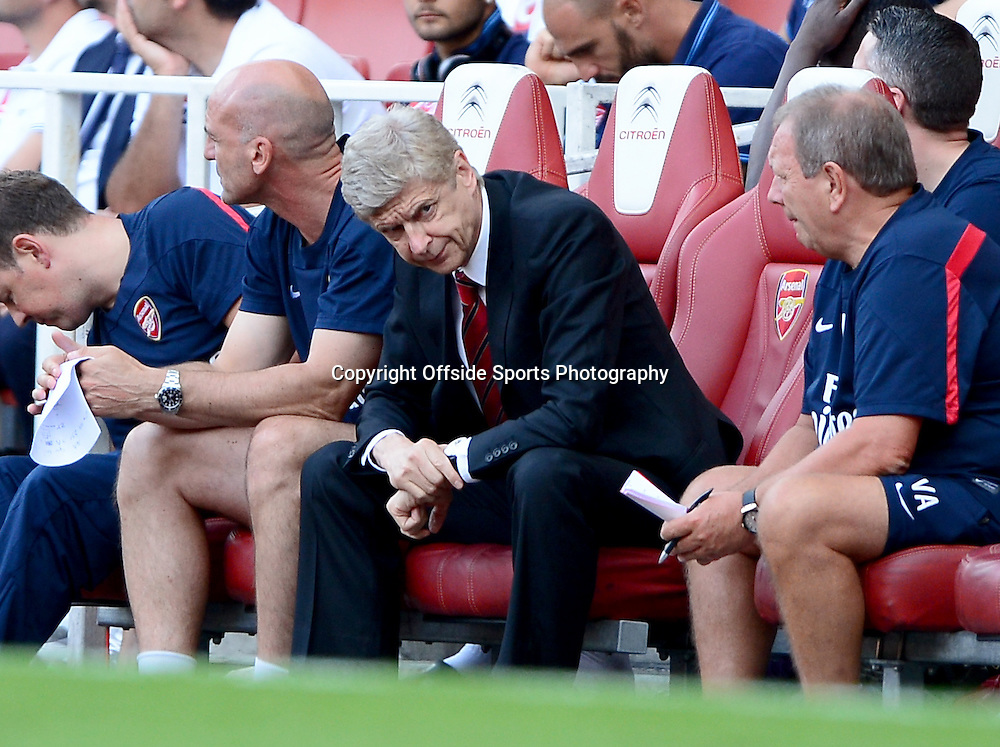 4th August 2013 - Emirates Cup - Arsenal v Galatasary - Arsene Wenger, Manager of Arsenal looks fed up - Photo: Marc Atkins / Offside.