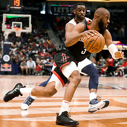 Mar 24, 2019; New Orleans, LA, USA; Houston Rockets guard Chris Paul (3) drives past New Orleans Pelicans guard Ian Clark (2) during the first half at the Smoothie King Center. Mandatory Credit: Derick E. Hingle-USA TODAY Sports