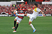 20.10.2013 Sydney, Australia. Wanderers Italian defender Iacopo La Rocca and Wellingtons midfielder Carlos Hernandez in action during the Hyundai A League game between Western Sydney Wanderers FC and Wellington Phoenix FC from the Pirtek Stadium, Parramatta. The game ended in a 1-1 draw.