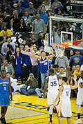 Golden State Warriors fans celebrate a blocked shot by forward Draymond Green (23) against the Oklahoma City Thunder at Oracle Arena in Oakland, Calif., on November 3, 2016. (Stan Olszewski/Special to S.F. Examiner)