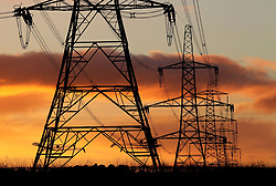File photo dated 24/11/10 of electricity pylons. UK households are overpaying for their electricity following Ofgem-set price controls that have resulted in excess profits for distribution companies, a charity has said.
