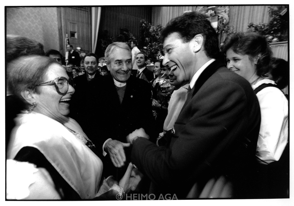 "November 16, 1991..Klagenfurt. Greeting guests at the ""Ka?rntner Ball"", with his wife Claudia (r). (Photo Heimo Aga)"