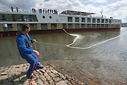 Making fast at Ru?desheim...M.S. Johann Strauss, a brand new four star+ river cruiser operated by Austrian River Cruises, and chartered by Club 50 (a travel agency especially for seniors aged 50 and up) undertook an epic 3-week journey (May 21 to June 10, 2004) all the way from Amsterdam to the Black Sea?along Rhine, Main and Danube?, presumably the first passenger vessel ever to have done so. This is one of the images recorded during this historic voyage.