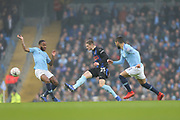 Rotherham United midfielder Ben Wiles (25) challenges 7 Raheem Sterling for Manchester Cityduring the The FA Cup 3rd round match between Manchester City and Rotherham United at the Etihad Stadium, Manchester, England on 6 January 2019.