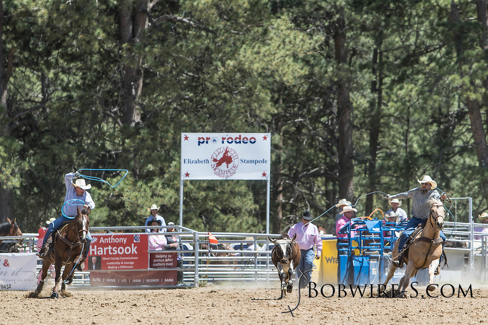Header Paul Beckett and heeler Chad Wahlert make their team roping run in the first performance of the Elizabeth Stampede on Saturday, June 2, 2018.
