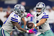 ARLINGTON, TX - OCTOBER 14:  Dak Prescott #4 hands off the ball to Ezekiel Elliott #21 of the Dallas Cowboys during a game against the Jacksonville Jaguars at AT&T Stadium on October 14, 2018 in Arlington, Texas.  The Cowboys defeated the Jaguars 40-7.  (Photo by Wesley Hitt/Getty Images) *** Local Caption *** Dak Prescott; Ezekiel Elliott