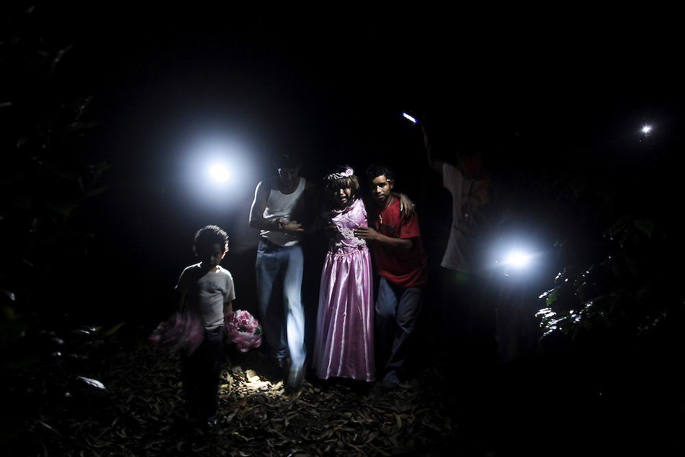 In this photo taken on Sunday, Sept. 11, 2011. A leukemia patient Maria Jose Martinez, center, cries, while she walks due to pain caused by the weakness of her body , she is assisted by her relatives after the mass celebration of the exact day of their birthday, at 'Las Cuchillas' Matagalpa city, north of Nicaragua.