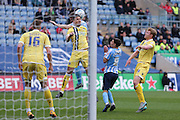 Millwall FC defender Joe Martin (3)  clears well from Coventry City defender Aaron Phillips (17) during the Sky Bet League 1 match between Coventry City and Millwall at the Ricoh Arena, Coventry, England on 16 April 2016. Photo by Simon Davies.