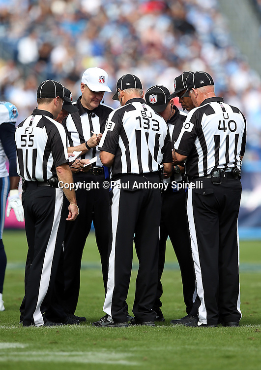 NFL officials huddle between plays during the Tennessee Titans NFL week 6 regular season football game against the Jacksonville Jaguars on Sunday, Oct. 12, 2014 in Nashville, Tenn. The Titans won the game 16-14. ©Paul Anthony Spinelli