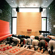 Halden Prison, Norway, June 2014:<br /> On Fridays, an imam visits the prison to pray with Muslim inmates. The chapel is being stripped for its Christian symbols, chairs are removed and carpets are placed carefully towards Mecca, according to the arrow upon the ceiling.<br /> -- No commercial use --<br /> Photo: Knut Egil Wang/Moment/INSTITUTE