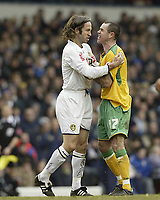 Photo: Aidan Ellis.<br /> Leeds United v Norwich City. Coca Cola Championship. 11/03/2006.<br /> Leeds Shaun derry and Norwich's Andy hughes clash