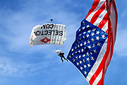 The American flag is brought into Nippert Stadium by parachute prior to the MLS soccer match between FC Cincinnati and the Columbus Crew, Sunday, Aug 25th, 2019, in Cincinnati, OH. (Jason Whitman/Image of Sport)