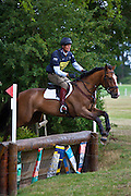 William Fox-Pitt, Olympic eventer, competing on Blue River bay horse at horse trials event in Little Mattingly, Hampshire, United Kingdom