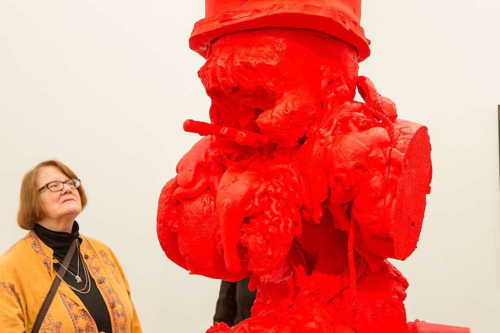 "New York, NY - 6 May 2016. Frieze New York art fair. A woman looks at the silicone cast sculpture ""SC Western Red River, Red"", by Paul McCarthy, in Hauser & Wirth."