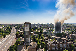 London, June 14th 2017. A fire rages through a residential tower block, Grenfell Tower, in Kensington, West London, with the entire building engulfed in flames. More than 200 firefighters are attending the incident and there are reports of people trapped inside. No figures are available as to casualties. PICTURED: As the tower blazes, the A40 Westway remains closed to traffic in both directions.