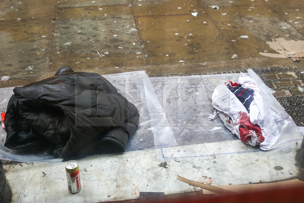 © Licensed to London News Pictures. 03/03/2019. London, UK. Clothing with blood stains at the rear entrance of The Coach and Horses pub in Romilly Street in Soho. According to the police, a man aged 30 yrs old is seriously injured in hospital and a woman has been arrested. Photo credit: Dinendra Haria/LNP