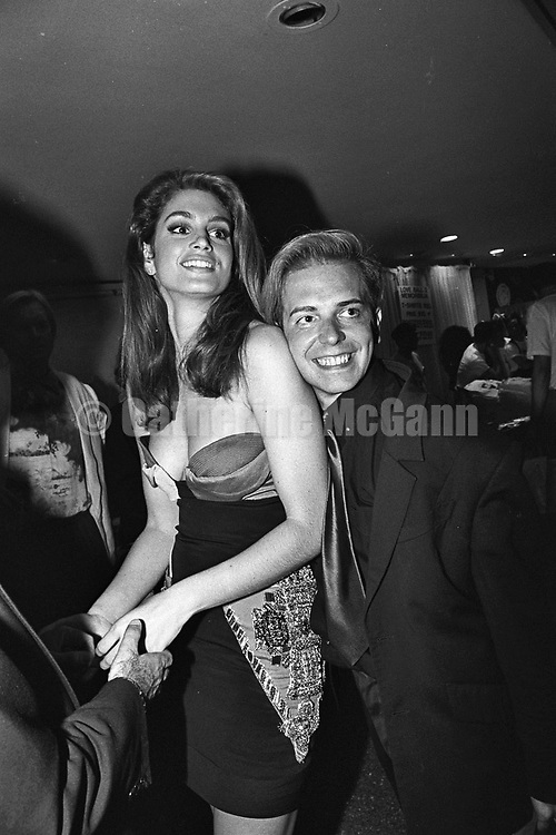 May 22, 1991:  Supermodel Cindy Crawford poses with a friend at the Love Ball on May 22, 1991 in New York City, New York.