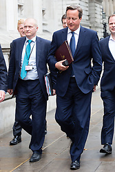 © Licensed to London News Pictures. 25/11/2015. London, UK. Prime Minister, David Cameron walking down Whitehall to the Houses of Parliament with his principal private secretary Chris Martin on 1st September 2014 to make a statement on measures to counteract the threat from ISIS. Chris Martin has died from cancer.  Photo credit : Vickie Flores/LNP