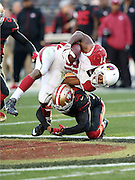 Arizona Cardinals running back David Johnson (31) gets his left leg twisted on a tackle by San Francisco 49ers cornerback Kenneth Acker (20) during the 2015 week 12 regular season NFL football game against the San Francisco 49ers on Sunday, Nov. 29, 2015 in Santa Clara, Calif. The Cardinals won the game 19-13. (©Paul Anthony Spinelli)