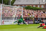 York GK Michael Igham can't stop Bradley Fewsters goal during the Friendly match between York City and Middlesbrough at Bootham Crescent, York, England on 11 July 2015. Photo by Simon Davies.