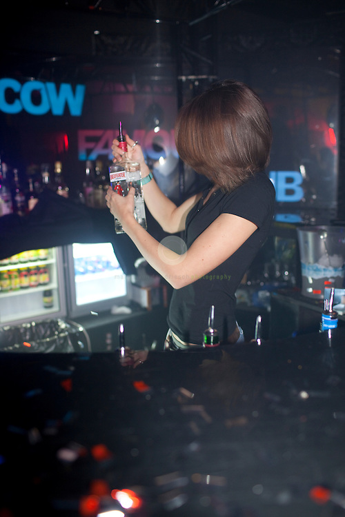 a night at club FAMOUS: EUROPE, RUSSIA, MOSCOW, 08.02.2009: since the wild 90s Moscow has a reputation for having a vibrant nightlife - with options running from rock and underground to electro and VIP-only clubs. In many of the so-called elite clubs you are only admitted after a strict face control. One of the most popular clubs in 2009 is the FAMOUS club, where guests are entertained by a sophisticated light show as well as by go-go dancers.