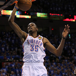 Jun 12, 2012; Oklahoma City, OK, USA;  Oklahoma City Thunder small forward Kevin Durant (35) dunks the ball against the Miami Heat during the fourth quarter of game one in the 2012 NBA Finals at the Chesapeake Energy Arena.  Mandatory Credit: Derick E. Hingle-US PRESSWIRE