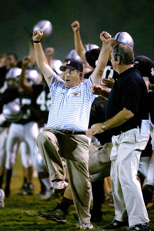 Coach Kevin Clancy reacts after his defense held rival Upper Darby's  line securing the Panthers victory. Strath Haven beat Upper Darby 20-13 in overtime at home on homecoming night .