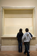 empty display case in museum with children reading the note with info of art which is not there Metropolitan Museum of Art New York
