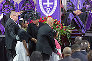 Jennifer Pinckney, center, and daughters Eliana, left, and Malana, wife of slain State Senator Clementa Pinckney walks past the casket of husband during the funeral service for the slain State Senator at the TD Arena June 24, 2015 in Charleston, South Carolina. Pinckney is one of the nine people killed in last weeks Charleston church massacre.